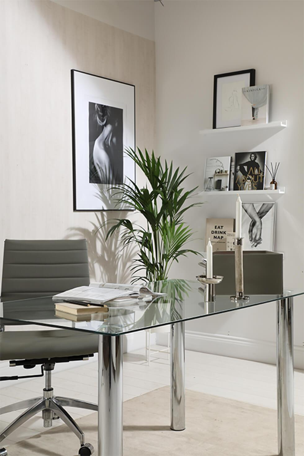 Home office with chrome table, grey chair and house plant