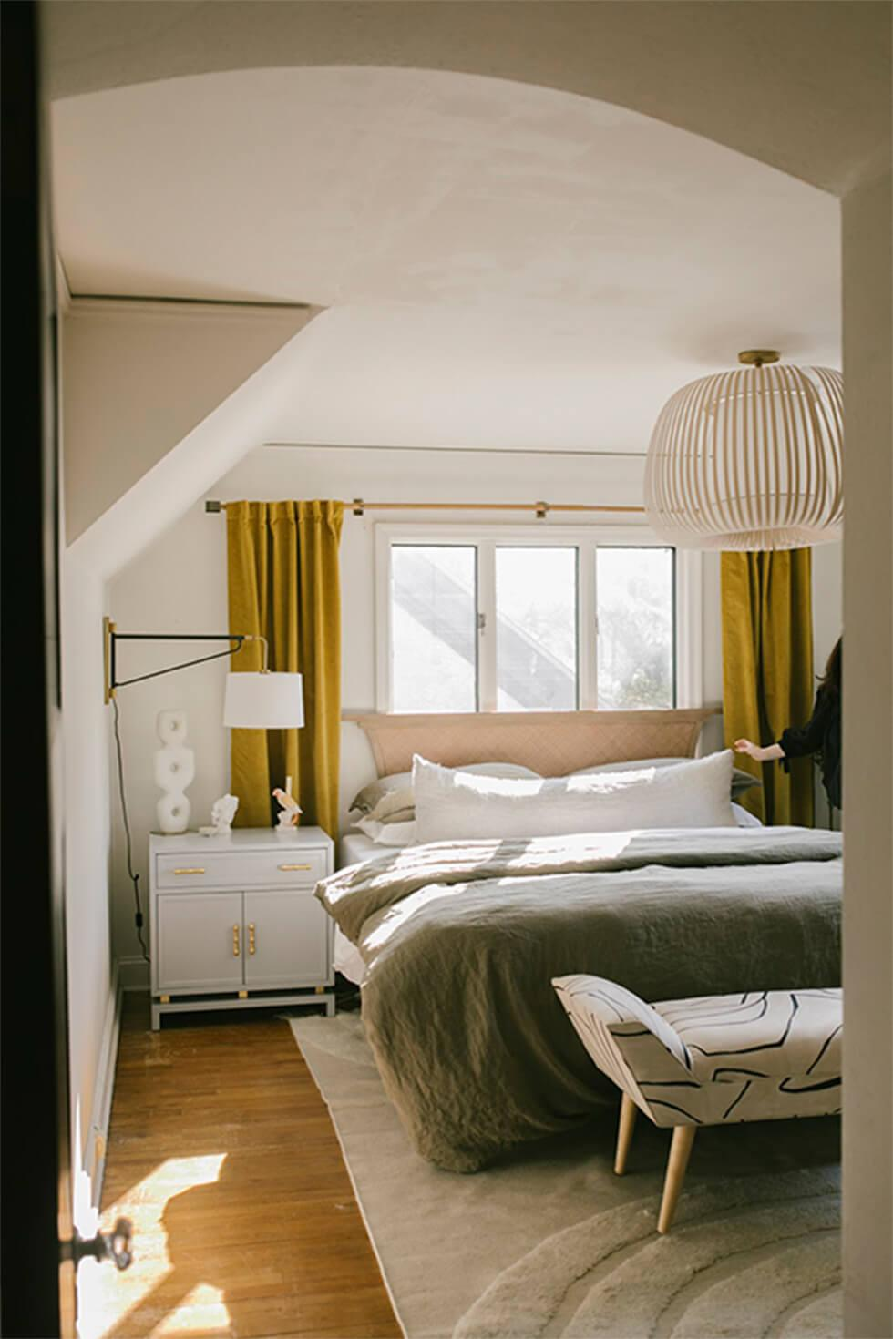 Monochrome bedroom with yellow curtains