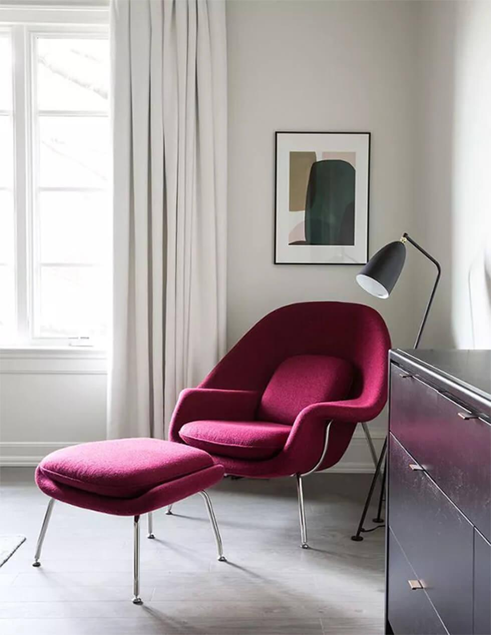 Monochrome living room with statement red armchair