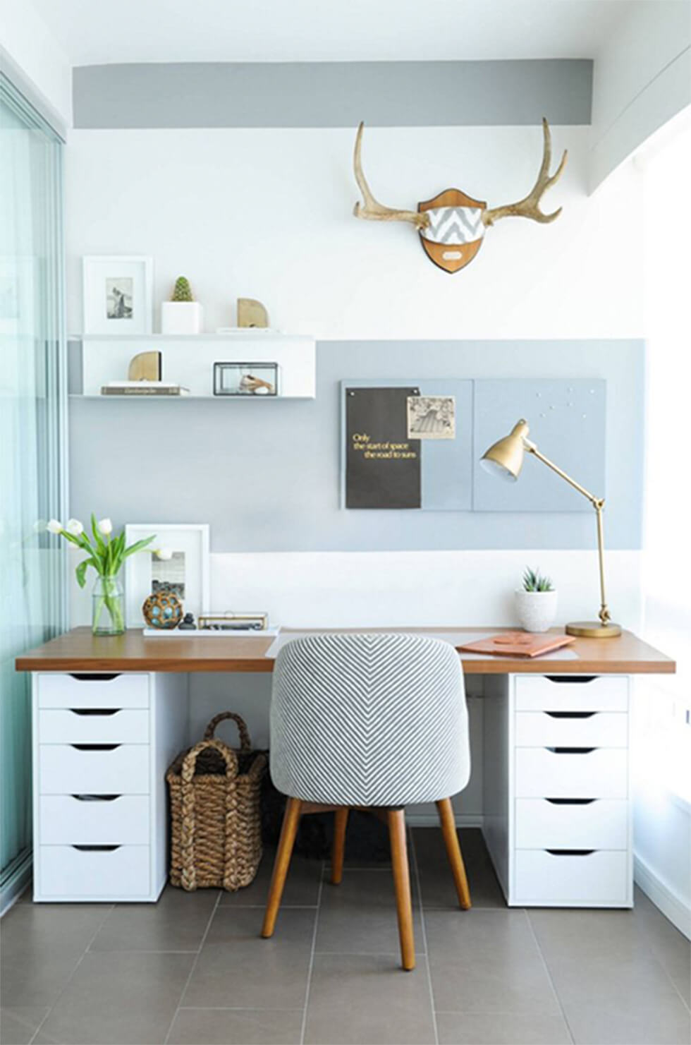 Home office with light blue walls, white walls and wooden accents