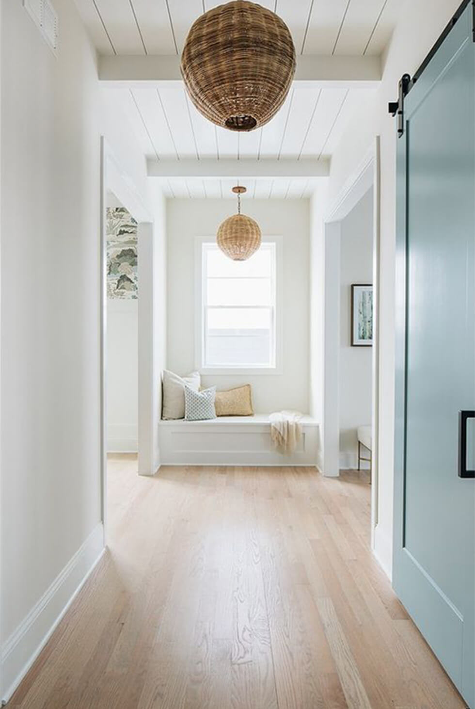 White and airy hallway with rattan lamps