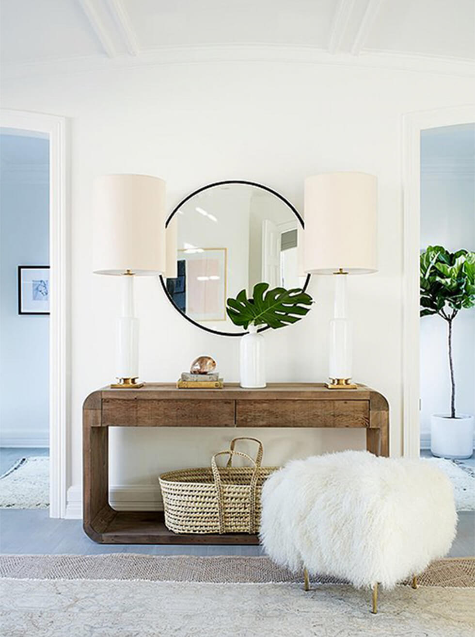 Round mirror with wooden sideboard