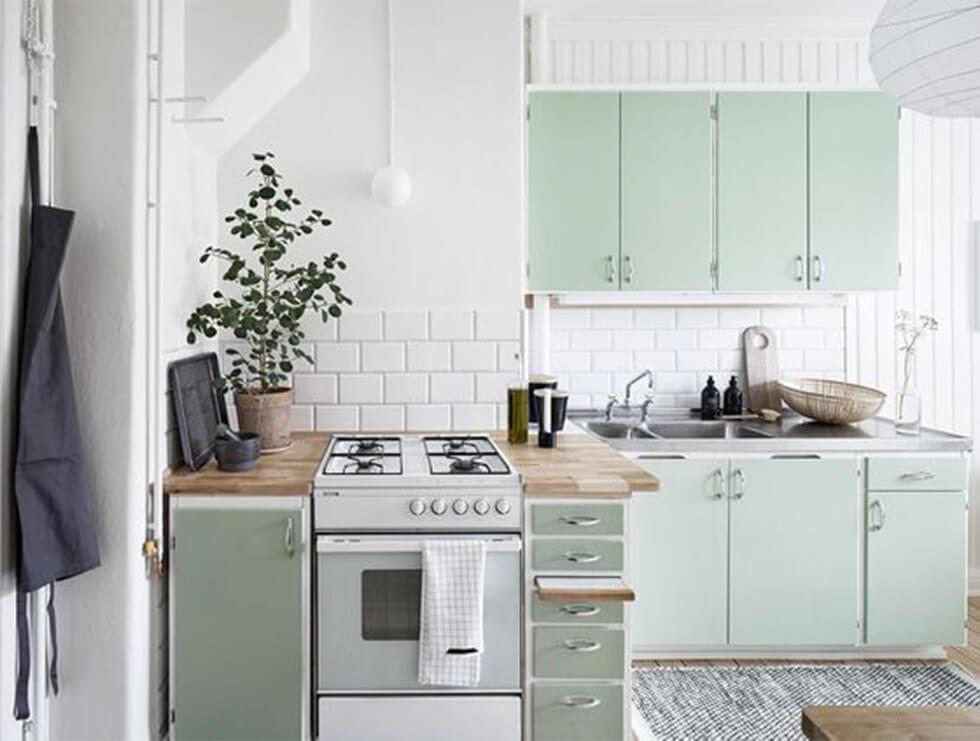 Sage kitchen with white walls