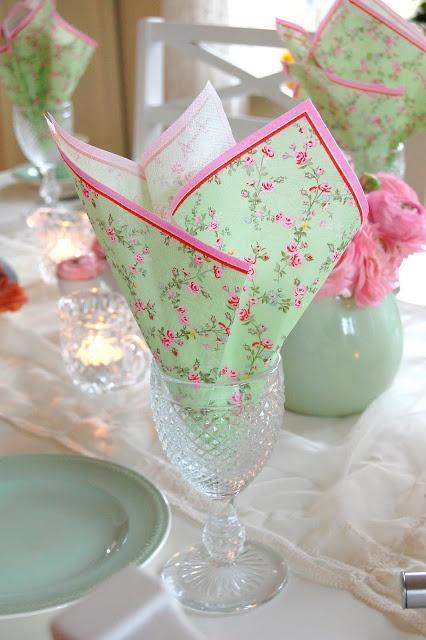 Floral napkins folded in glasses