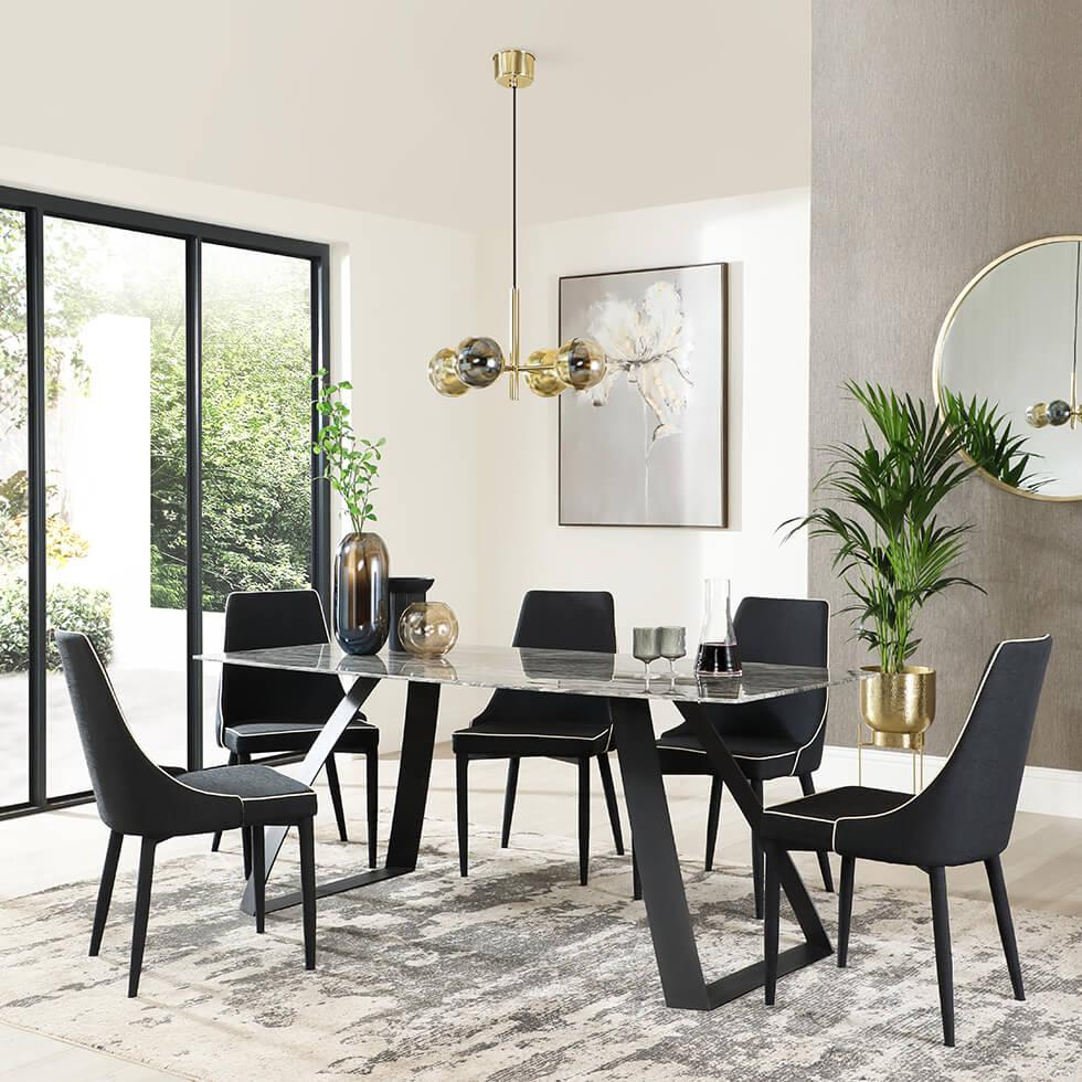 luxurious marble dining table and black fabric chairs in a modern dining space