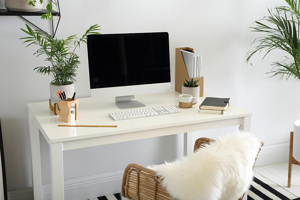 white dining table used as a work desk in a modern home office