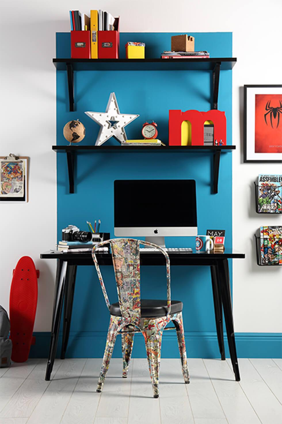 Home office with half-painted blue walls