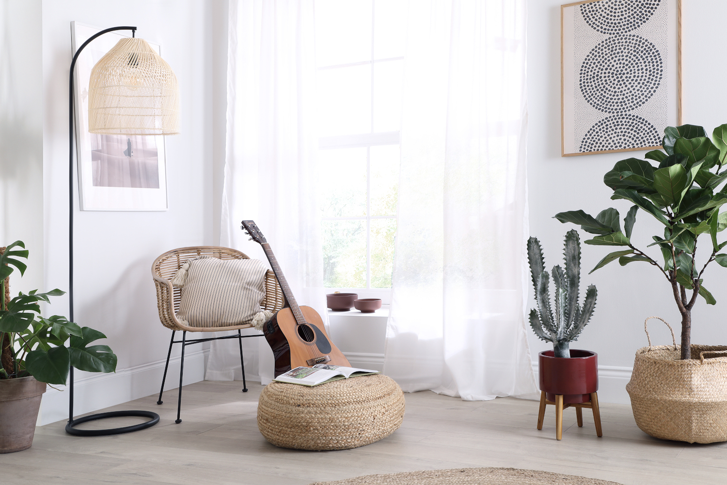 Boho room with rattan chair and lamp, and indoor plants