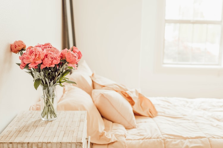 Calm peach bedroom with pink flowers