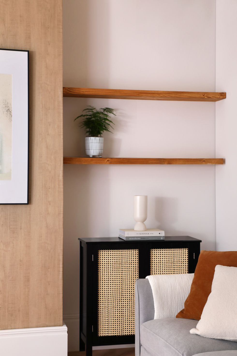 Modern living room with a potted plant on the wooden shelf