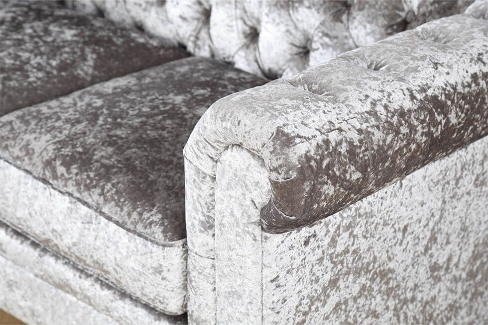 Close up of crushed velvet Chesterfield sofa