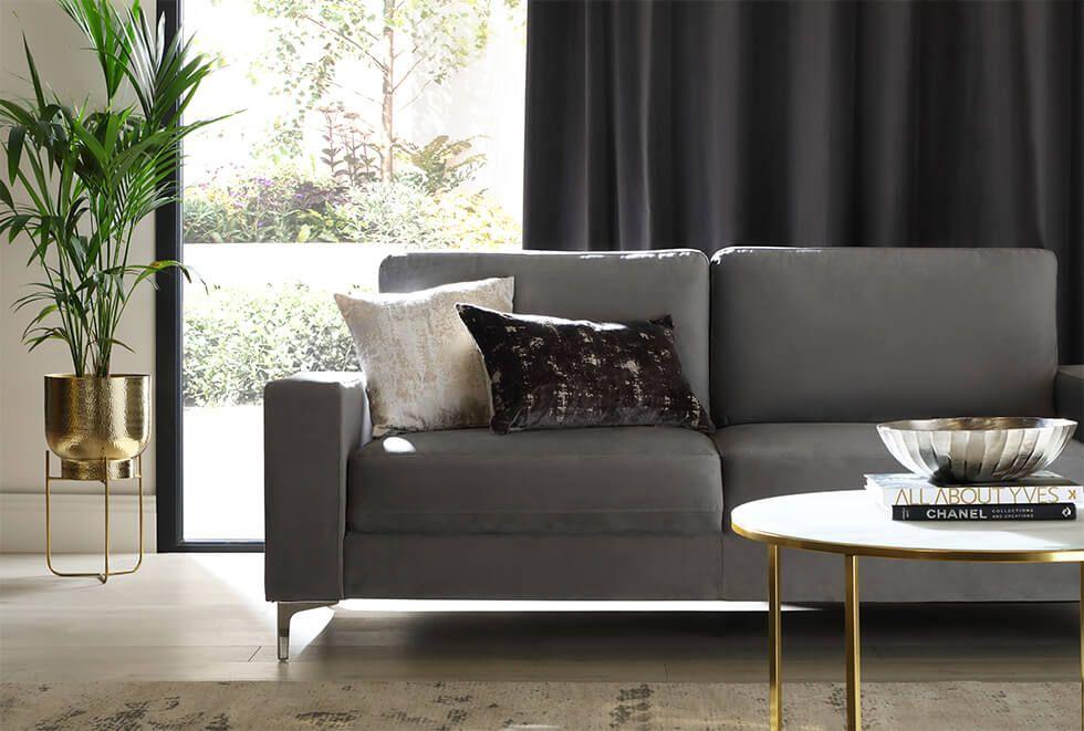 Grey velvet sofa in luxe living room