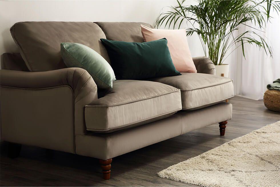 Velvet sofa with velvet cushions