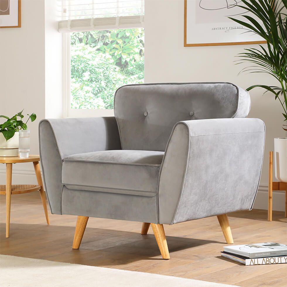 Minimalist velvet armchair in contemporary living room