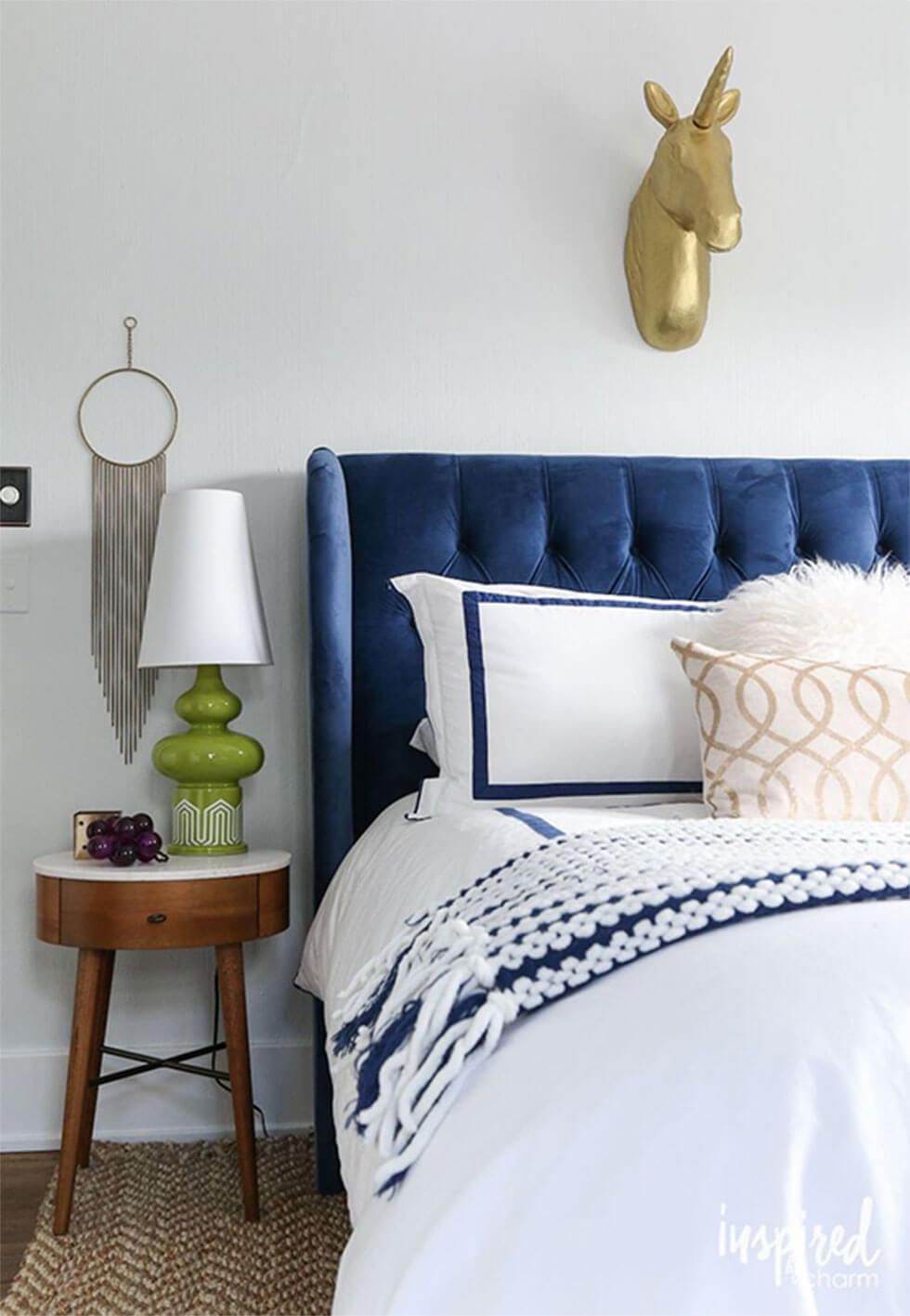 Classic Blue velvet headboard in bedroom with blue and white accents