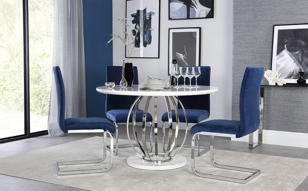 White high gloss table with chrome legs with blue chrome chairs in the dining room