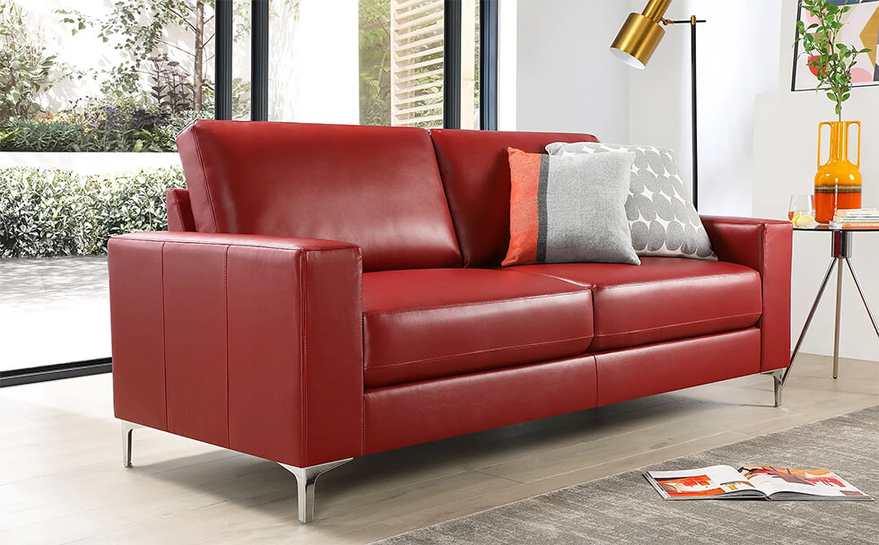 Bold red leather sofa in a modern living room with grey pillows