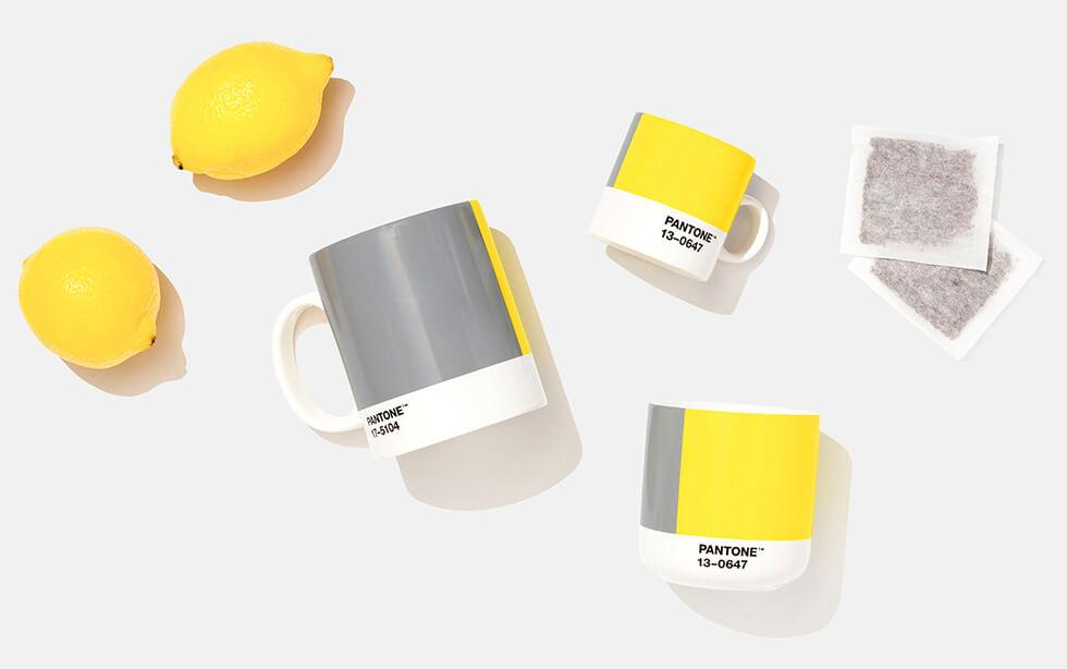 Flat lay of lemons, Pantone mugs and tea bags