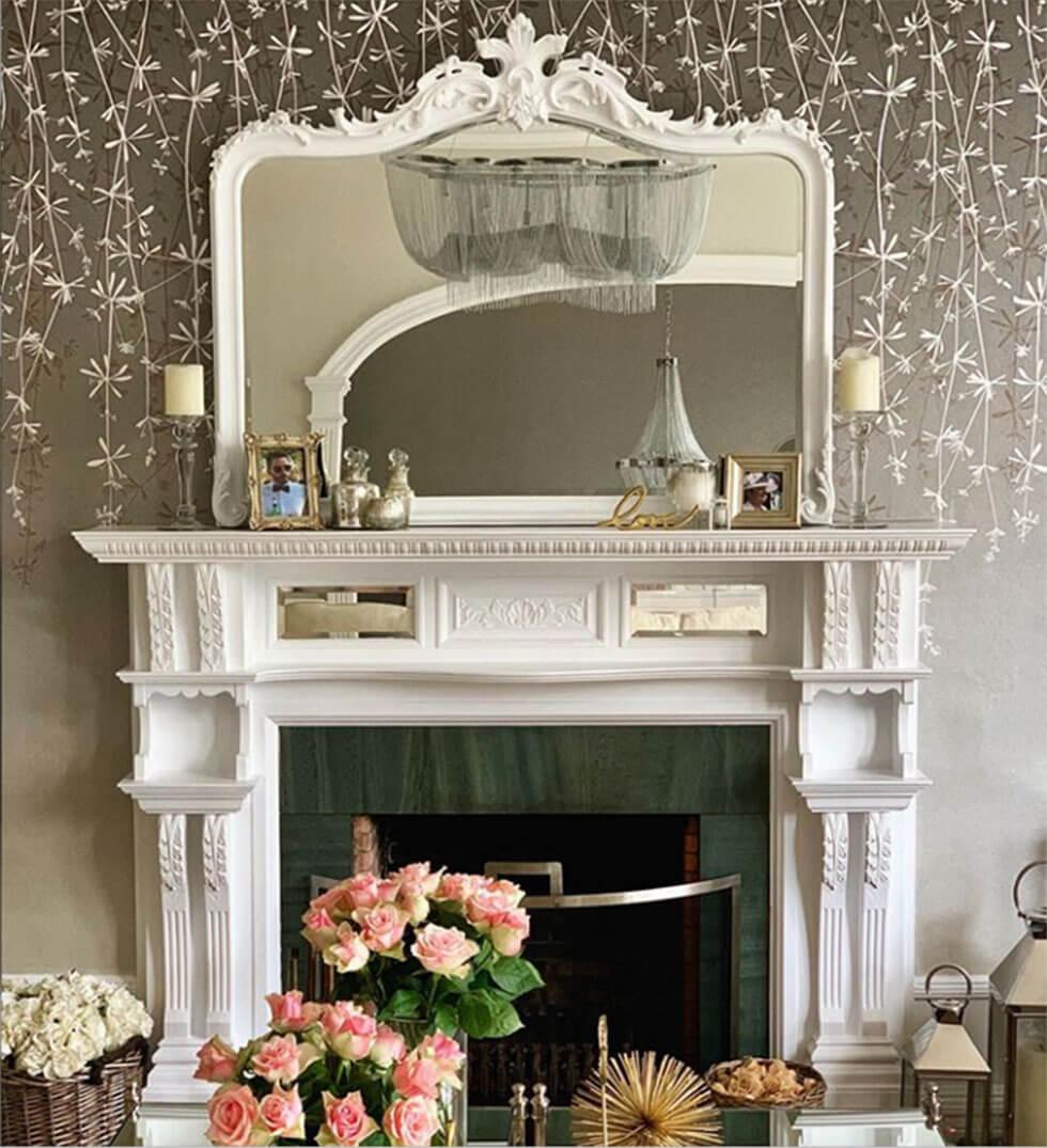 White fireplace with mirror and chic accessories