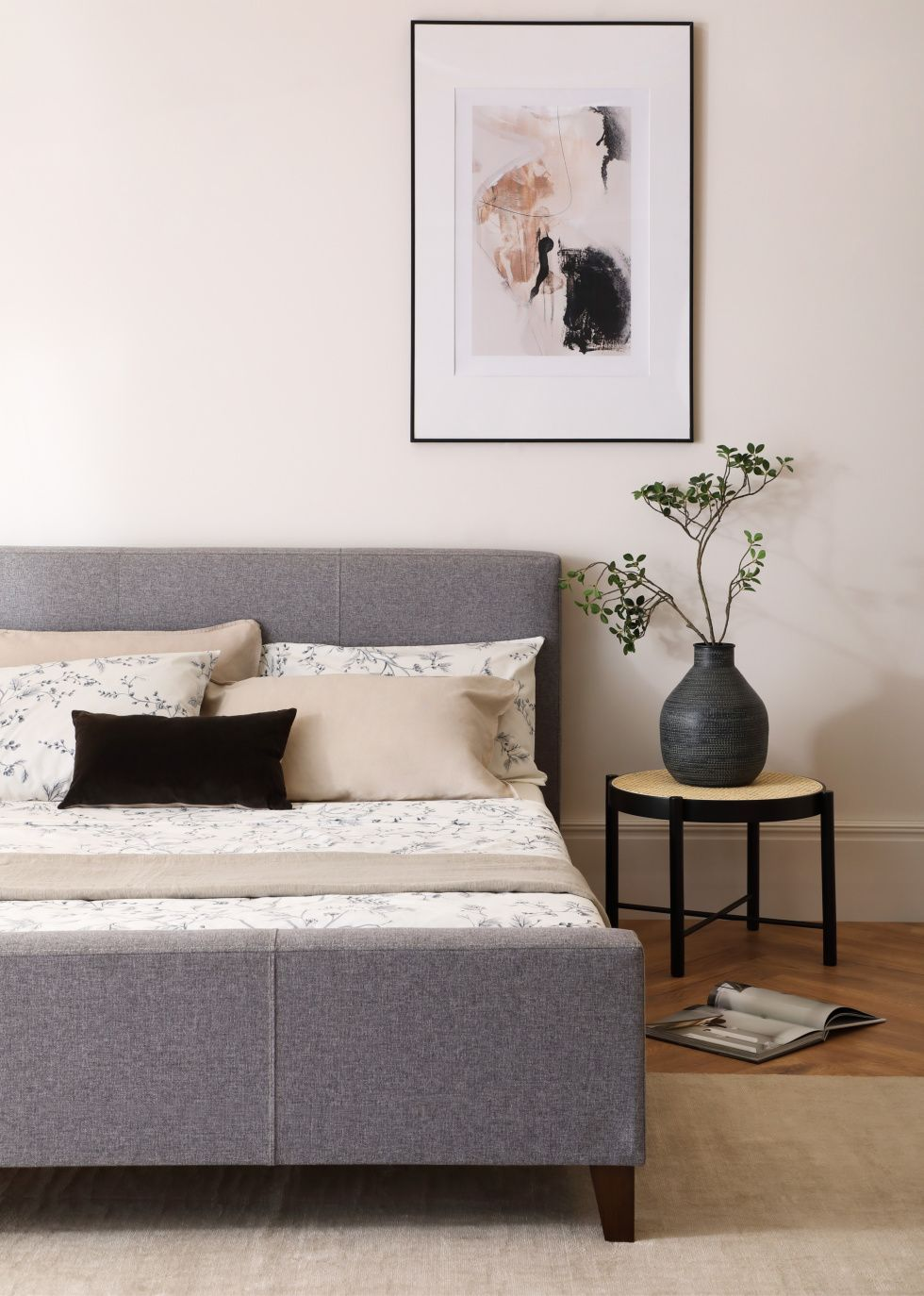 Grey fabric bed in a Japandi bedroom