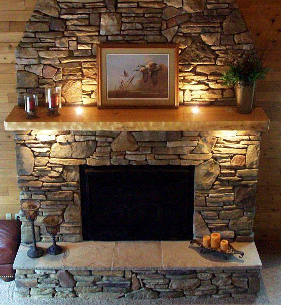 Stone fireplace with warm lighting