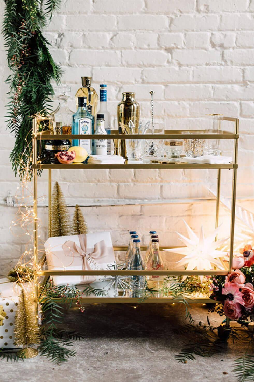 Holiday bar cart decorated for a fancy Christmas party.