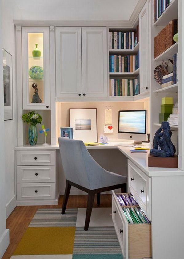 Office nook with white cupboards and grey chair.