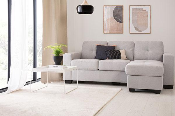 Beige armchair with cosy, furry rug