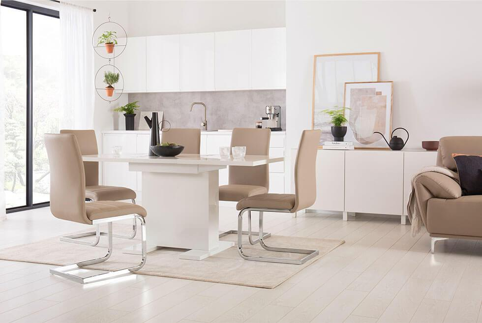 Glossy white dining table with matte dining chairs.