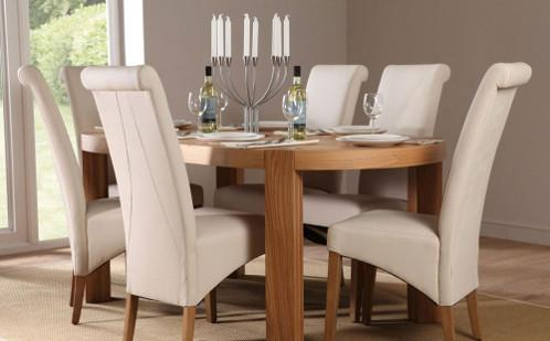 Wood dining set with white leather chairs.