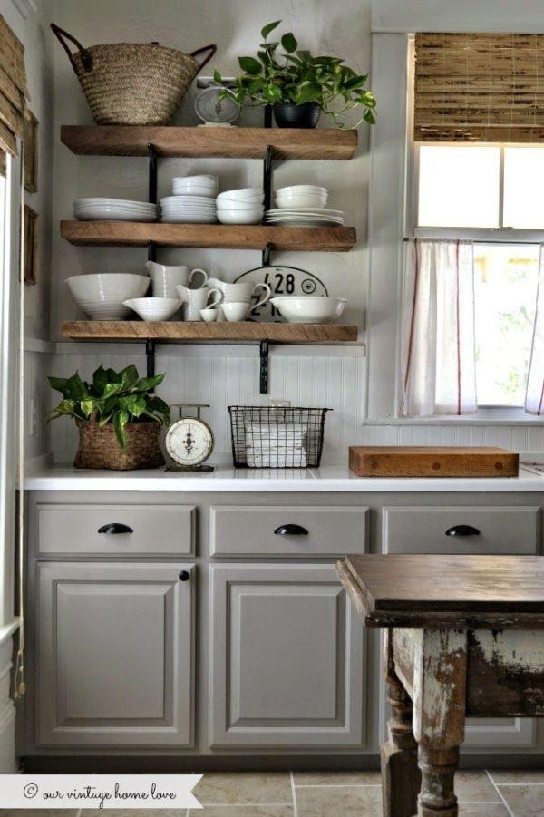 Grey and white kitchen with wooden shelves
