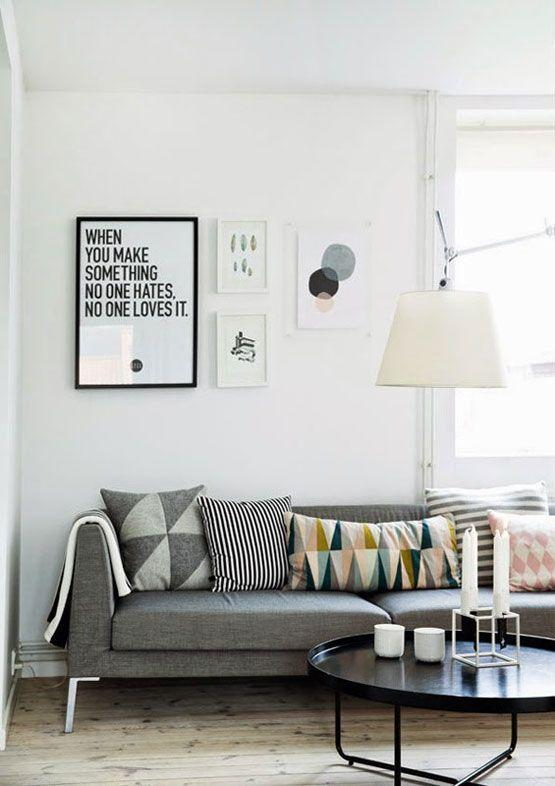 Grey sofa with graphic throw cushions