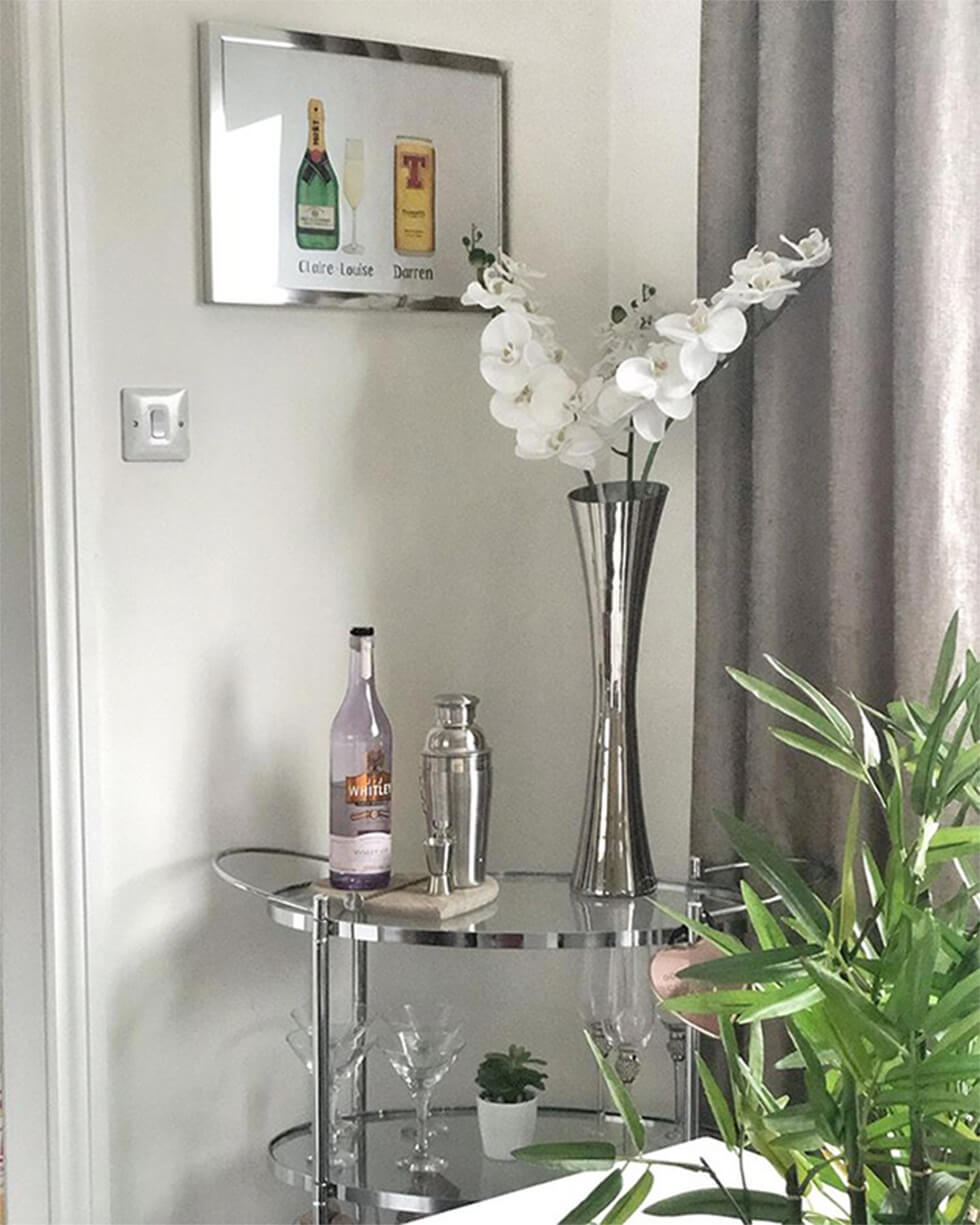 chrome and glass drinks trolley in a corner of the room