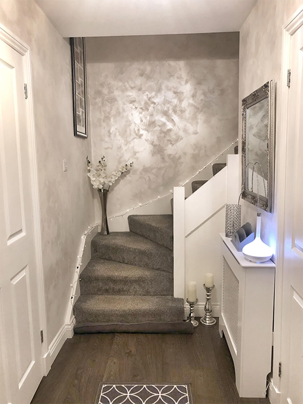 metallic silver painted walls on a modern stairway