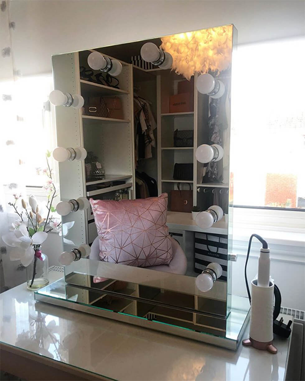 mirror with feature lights in a modern chic dressing room