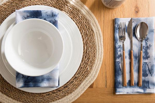 dining flat lay with blue napkins