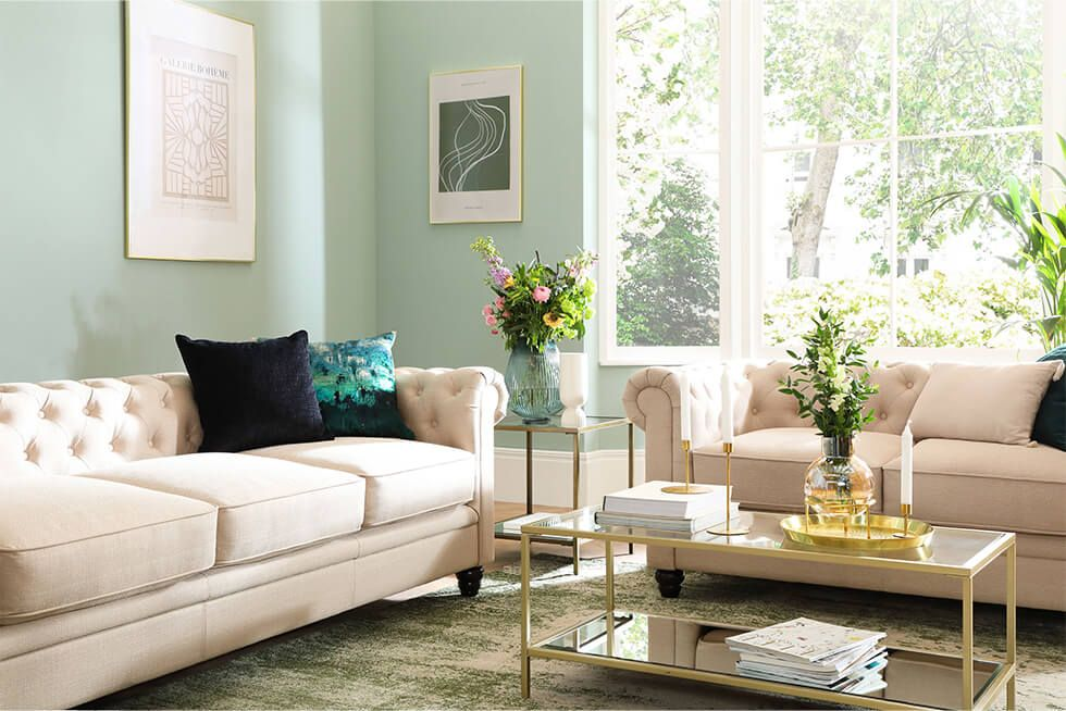 ivory leather chesterfield sofa set in a relaxing summer style living room