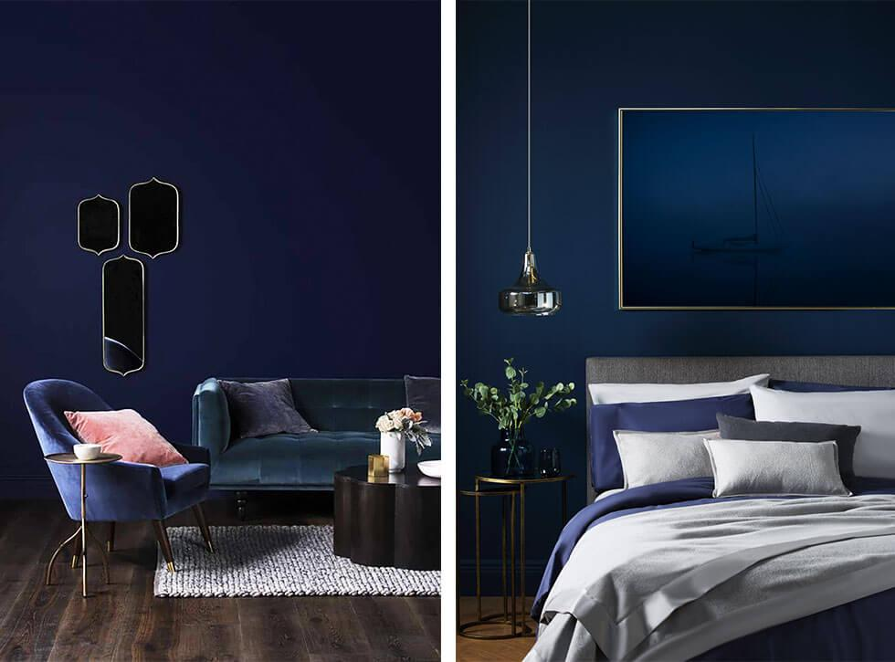 Rich blue rooms with dark matching sofas and bed.