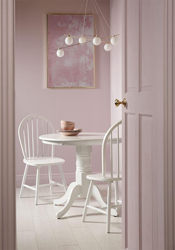 Light mauve room with white dining set.My Domaine, One Kings Lane