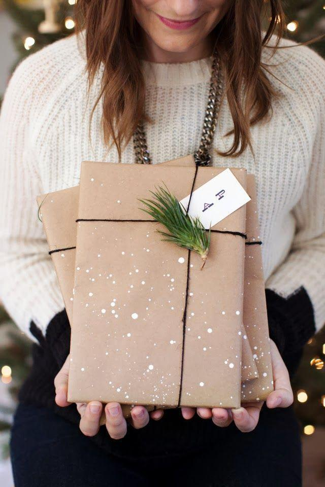 Girl holding two wrapped presents.