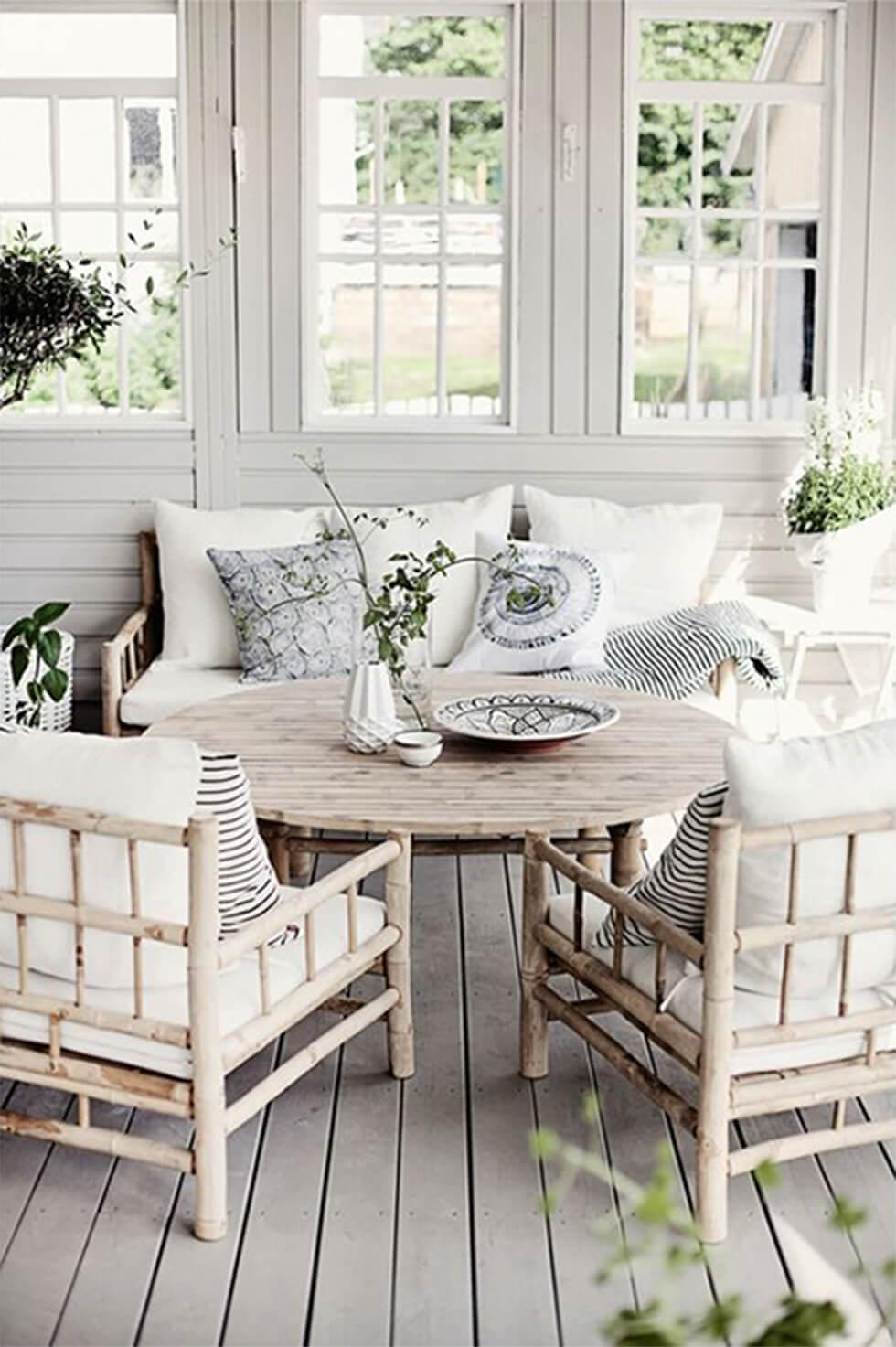 Rattan chairs in rustic outdoor patio