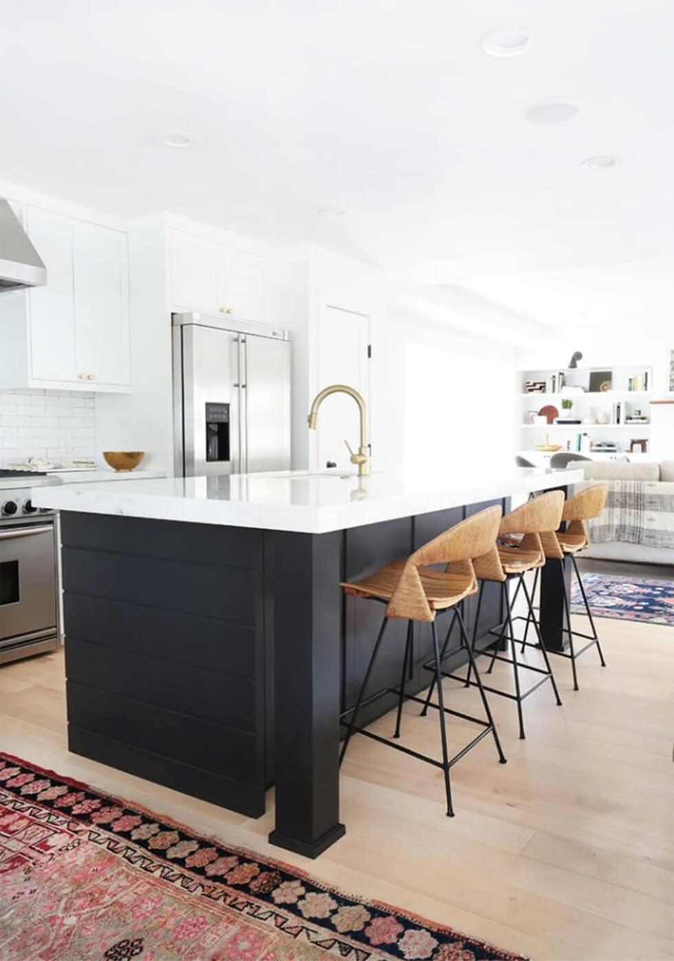 Contemporary kitchen with rattan bar stools