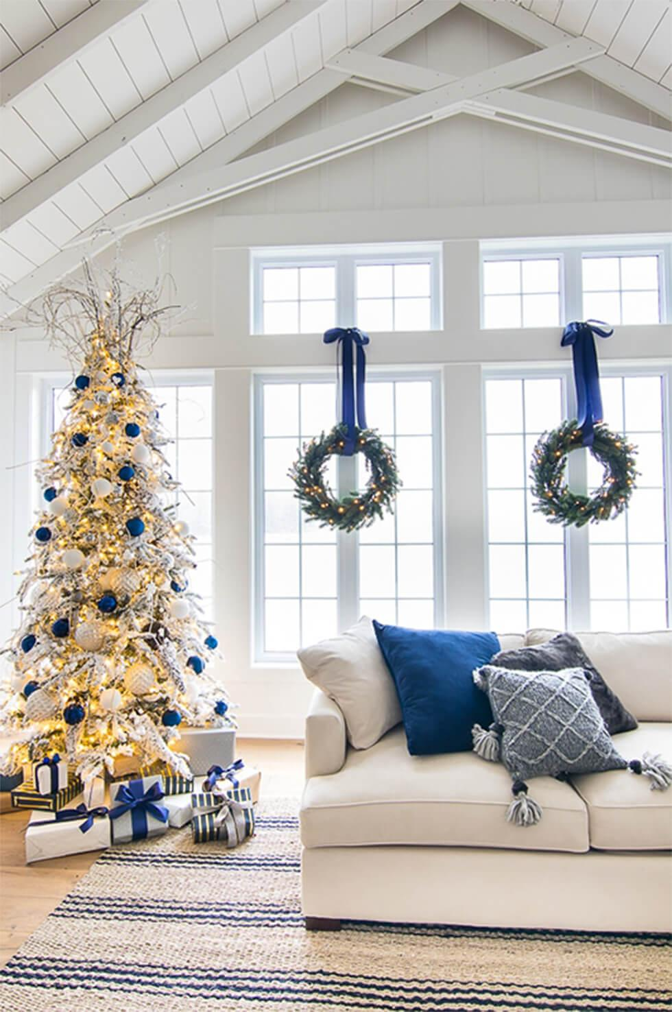 White Christmas living room with blue accents and decor