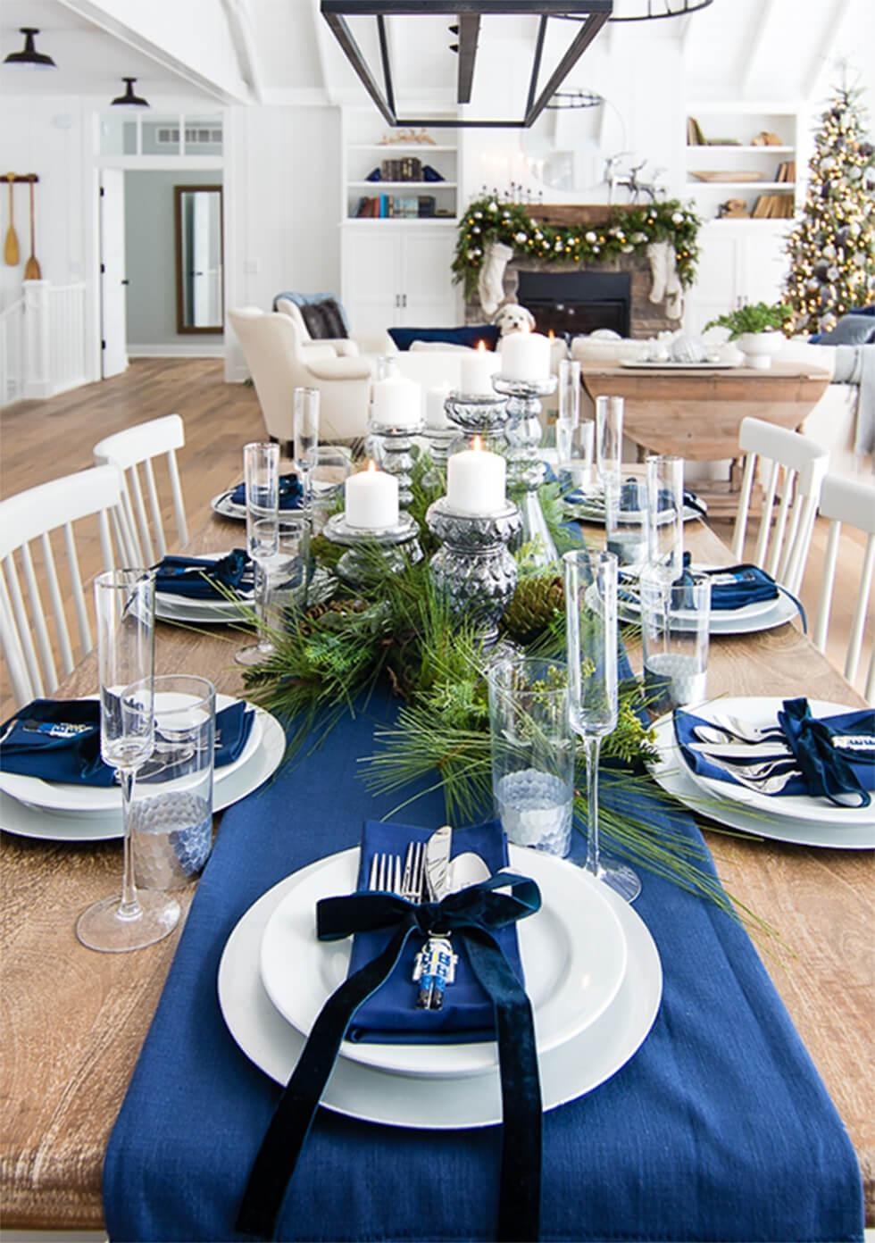 Wooden dining table with blue and white settings