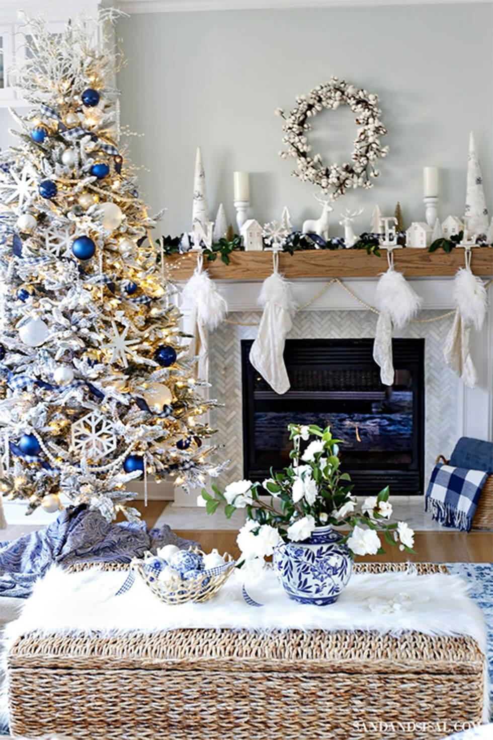 Living room with Christmas tree and stockings, tinsel and blue decor