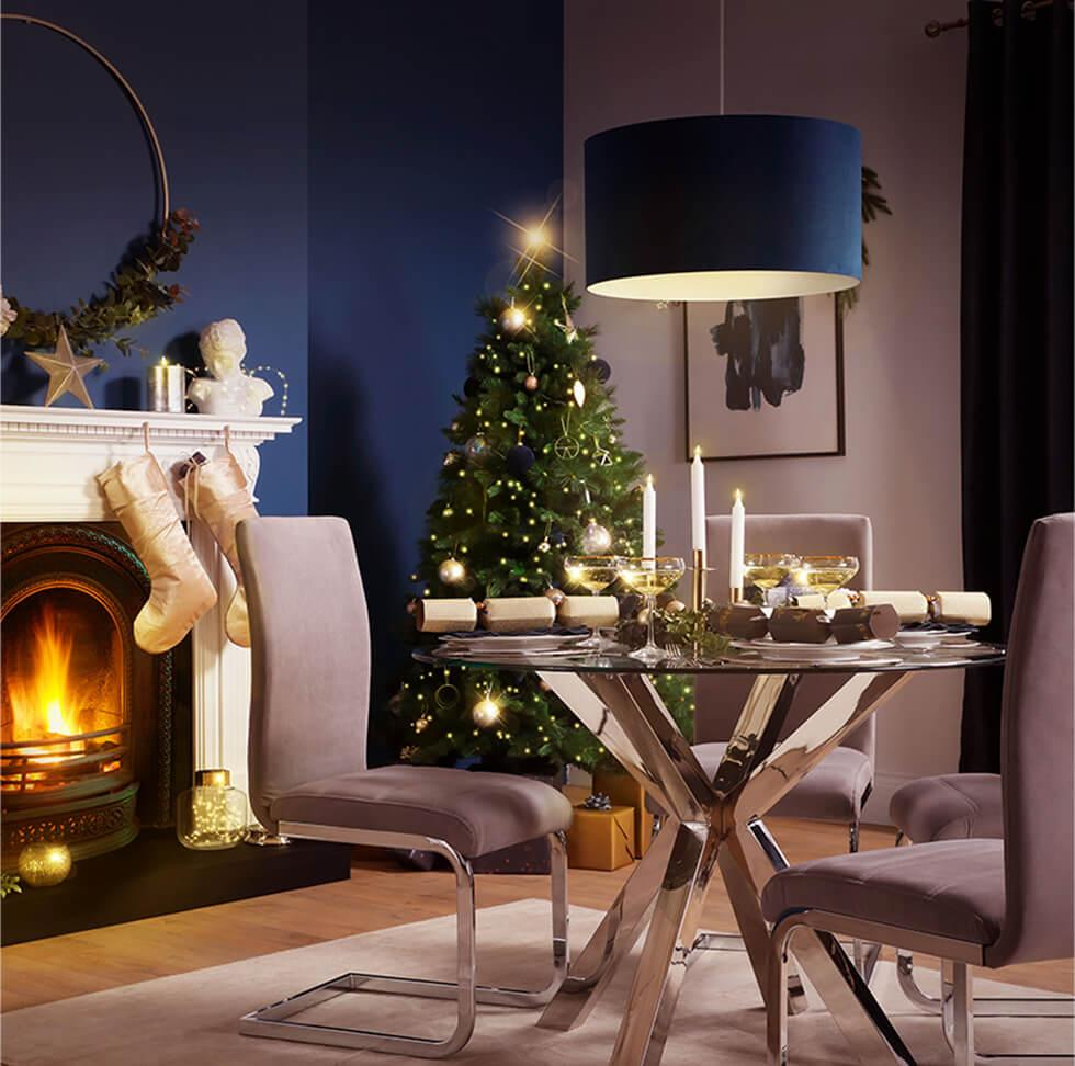 Blue Christmas dining room with chrome pedestal table and taupe chairs