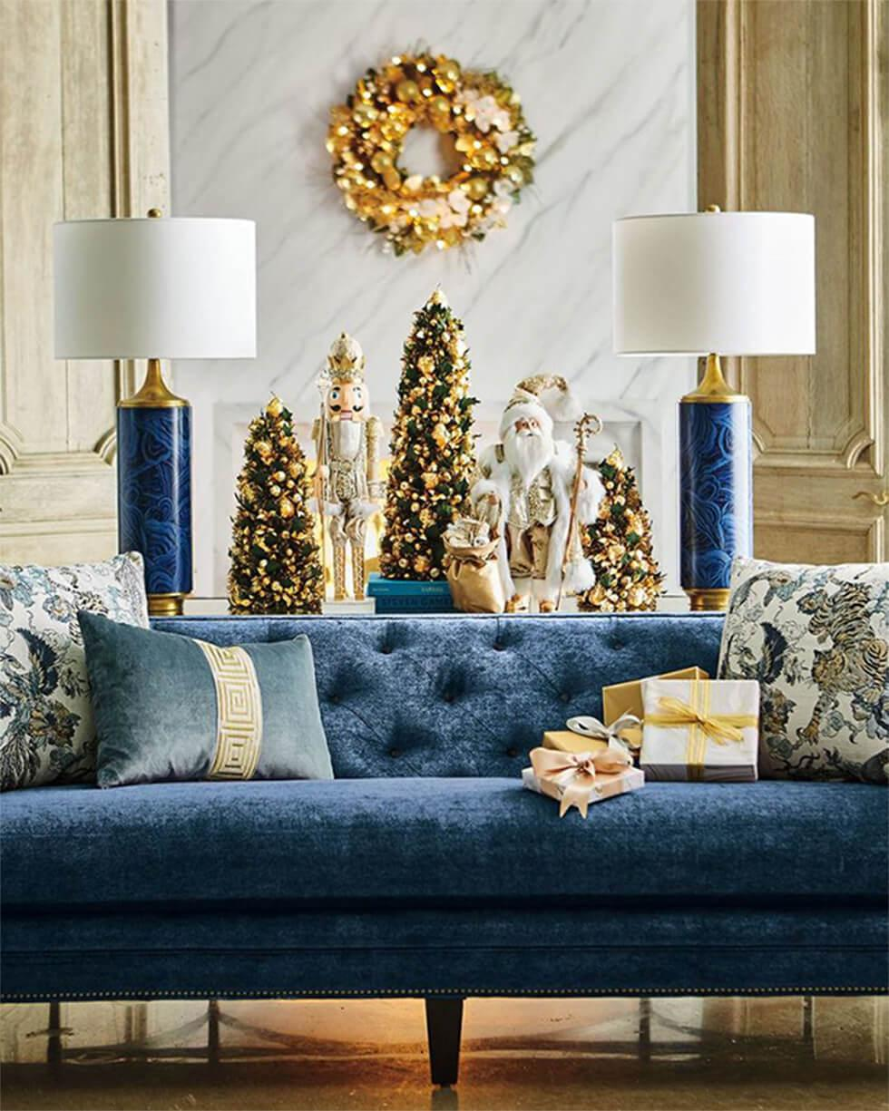 Blue and white living room with gold Christmas decor