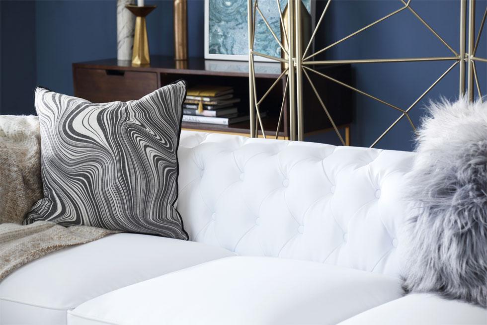 Textured pillows and white sofa.