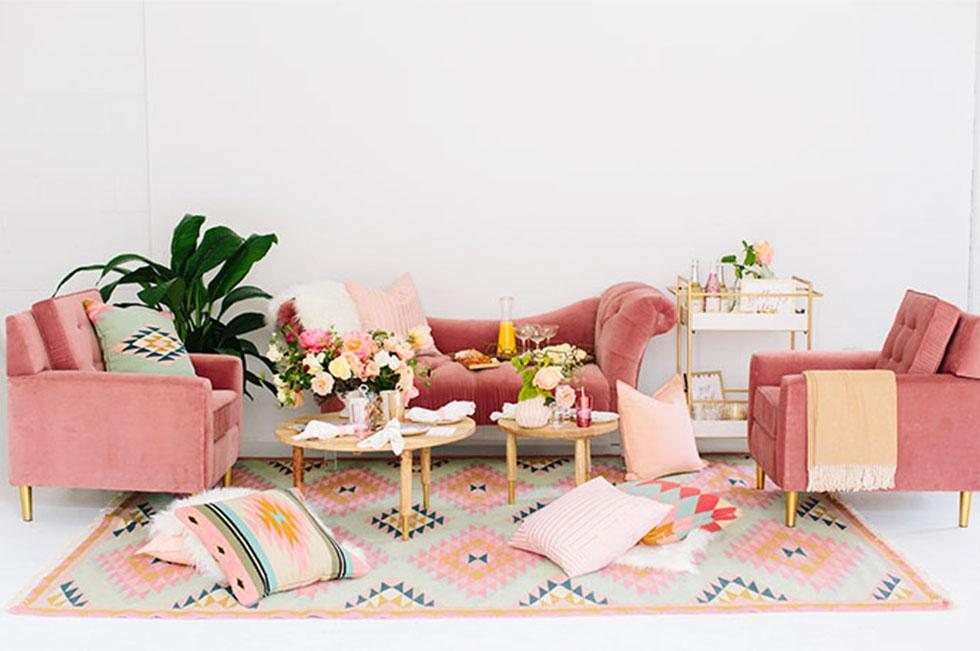 Pink sofas with assorted pastel decor.