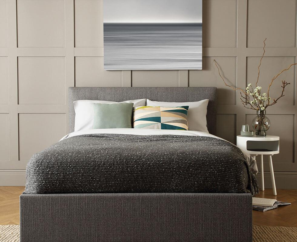 Light grey bedroom with grey bed.